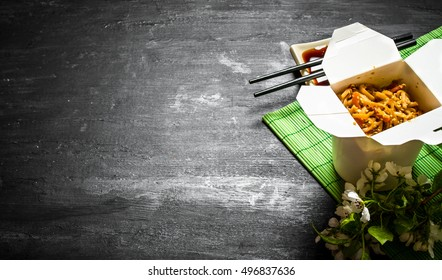Chinese food . Noodles with shrimp, vegetables and sesame with soy sauce.