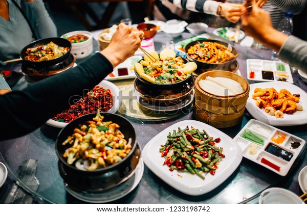 Chinese food on the round table and Peking duck