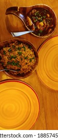 chinese food on a wooden table, chilli paneer and fried rice