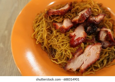 Chinese food, roasted pork and Lo mein noodle