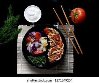chinese food set on black stone background, top view