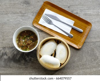Chinese food a steamed pork and steamed stuff bun is a steamed filled bun