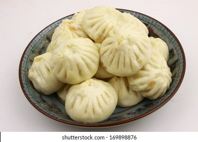 chinese food steamed stuffed bun closeup photograph isolated on white background