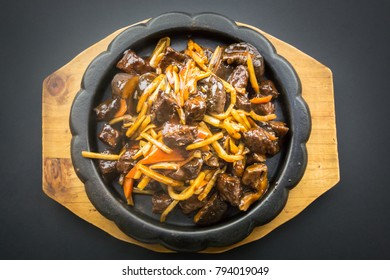 Chinese food. Stir-Fried Bamboo Shoots and beef with Shiitake Mushrooms on black background.