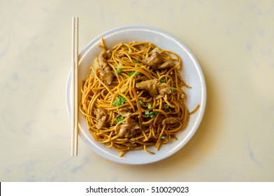 Chinese food tasty chicken lo mein noodles at restaurant