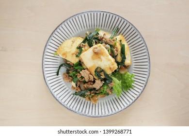 Chinese food, tofu and leek stir fried with mince pork