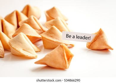 Chinese fortune cookie with prediction on white background
