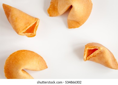 Chinese fortune cookie with prediction on white background top view