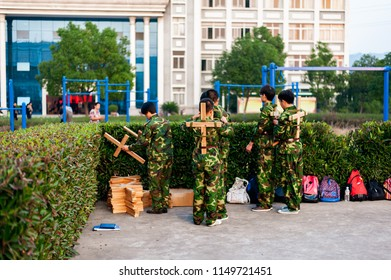 Chinese freshmen college students are getting ready for military training at school