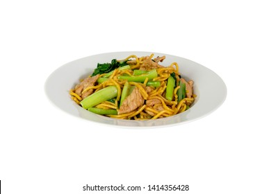 Chinese fried noodles with pork And Cantonese vegetables, Hokkien Noodles, Phuket traditional food, isolated white background, clipping path.