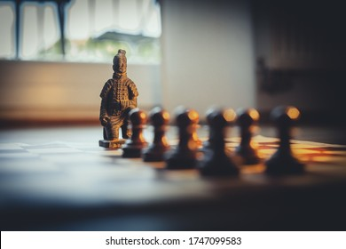 Chinese general on a chessboard close up view.