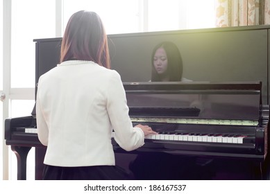 Chinese girl playing the piano