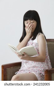 chinese girl reading boring story