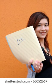 A Chinese girl shows full mark on sheet