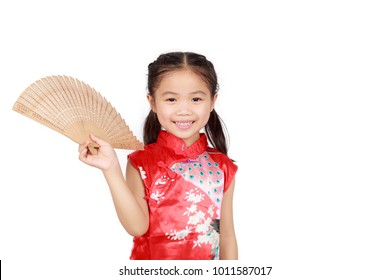 Chinese girl standing smiling in her hand holding a wooden blower.