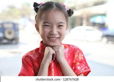 Chinese girl in traditional Chinese cheongsam