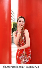 Chinese girl with chinese traditional dress ,chinese new year,red-cheongsam
