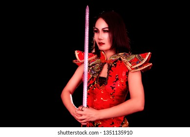 Chinese girl warrior with a sharp sword in his hands.