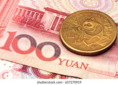 A chinese gold coin on a background of chinese money