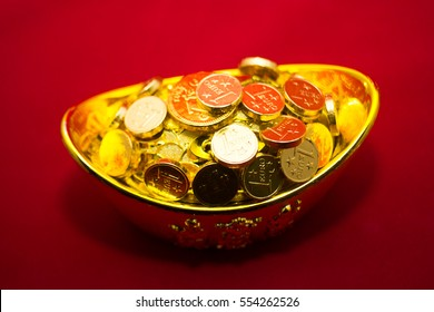 Chinese Gold ingot (Sycees, YuanBao ) are used a symbol of prosperity among Chinese people. representing a fortunate year to come. On red color background