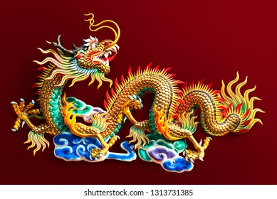 Chinese golden dragon statue for decoration in the public temple isolated on red background with clipping path