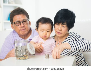 chinese grandparents with grandson saving concept photo