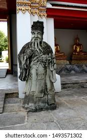 Chinese guardian figure inside wat pho temple in Bangkok Krung thep