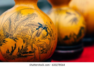 Chinese handmade souvenir - carved Calabash, amulet for good health, money and luck on a street market near Kumbum monastery in Qinghai Sheng, Xining Shi, Huangzhong Xian, China
