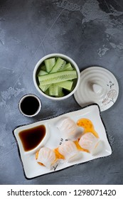 Chinese har gao on a grey concrete background, flatlay, vertical shot