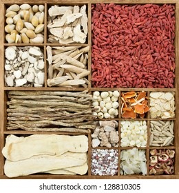 Chinese herb medicines in a rustic wooden box