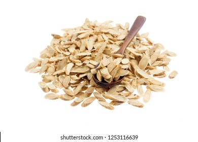 Chinese Herbal medicine - Astragalus slices, Huang Qi (Astragalus propinquus, on white background (manual focus,