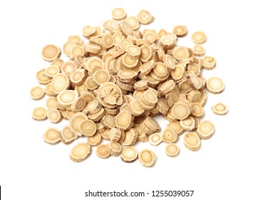 Chinese Herbal medicine - Astragalus slices, Huang Qi (Astragalus propinquus) on white background (manual focus)
