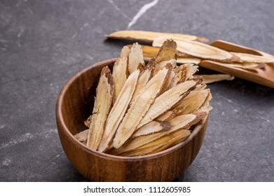 Chinese herbal medicines -- Astragalus on stone background, blank for text, copy space