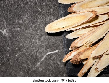 Chinese herbal medicines -- Astragalus on stone background