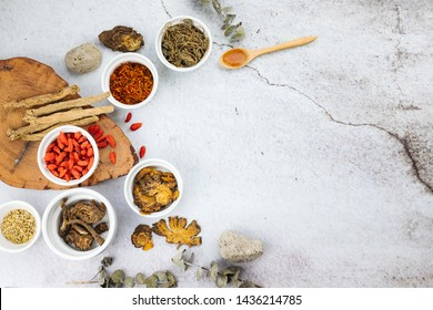 Chinese herbs with copy space and flat lay composition. Variety of dried tea, dried herbal, green, black tea and fruit tea. Table wood top view.