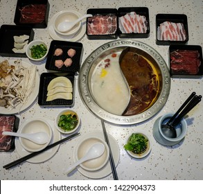 Chinese hotpot or steamboat with choice of two broth / Spicy Mala & Pork Bone Broth Hotpot / Choices of pork or beef thinly sliced, leaf vegetables, mushrooms, seafood, dumplings and dipping sauces