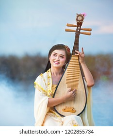 CHINESE INSTRUMENT.Beautiful Chinese woman  musical instrument