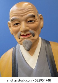 Chinese / Japanese statue of artist  close-up of face on a blue background Circa 1950