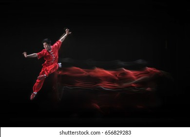 Chinese Kung Fu Performer during Practice in Jakarta Indonesia. Shot under several lights to get the effect of movements. Date taken 27 May 2012