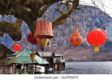 Chinese lampions at the tree at Hallstatt village in Alps, Tirol, Austria