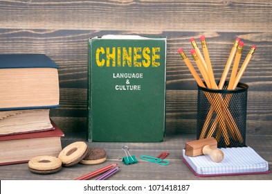Chinese language and culture concept. Book on a wooden background
