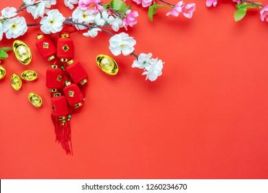 Chinese language mean rich or wealthy and happy.Top view aerial image decoration Chinese new year & lunar new year holiday background concept.Flat lay red lantern with blossom on modern red wooden.