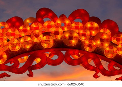 Chinese lantern shaped like traditional charms and coins, silk
