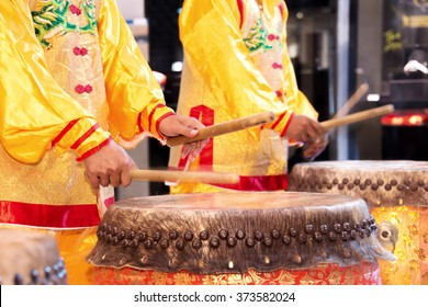 Chinese lion dance drummer beating drum in the show