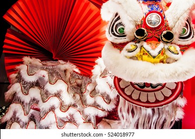 741be392b Chinese lion dance for Chinese new year with red fan in the background