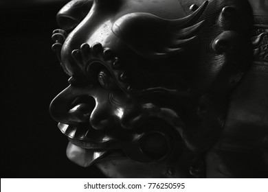 Chinese lion statue closed up on black background
