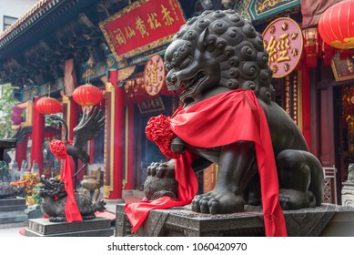 Chinese Lion statue in Wong Tai Sin Temple in Hong Kong, China. The Chinese wording is the name of the temple and not a brand name
