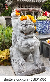Chinese Lion Stone Statue with Marigolds garlands on head