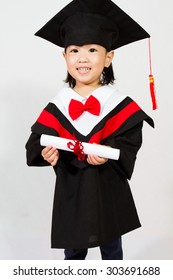 Chinese little girl graduation in white backround studio shot.