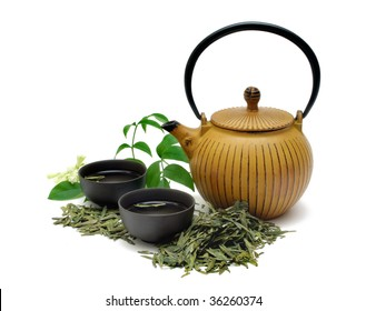 Chinese Long Jing green tea with small pot and cups isolated on white